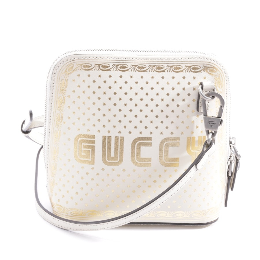 evening bags from Gucci in cream and gold - logo moon & stars