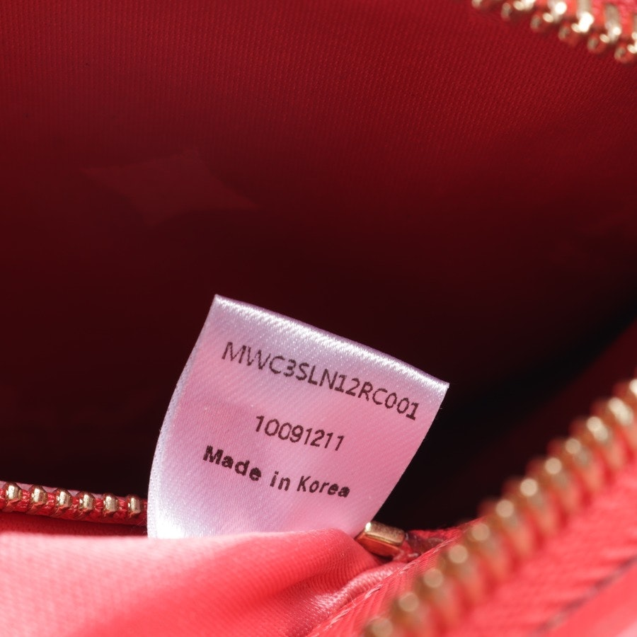 shoulder bag from MCM in coral red
