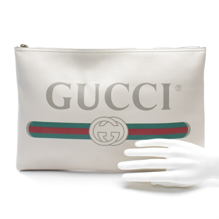 clutches from Gucci in beige - multi