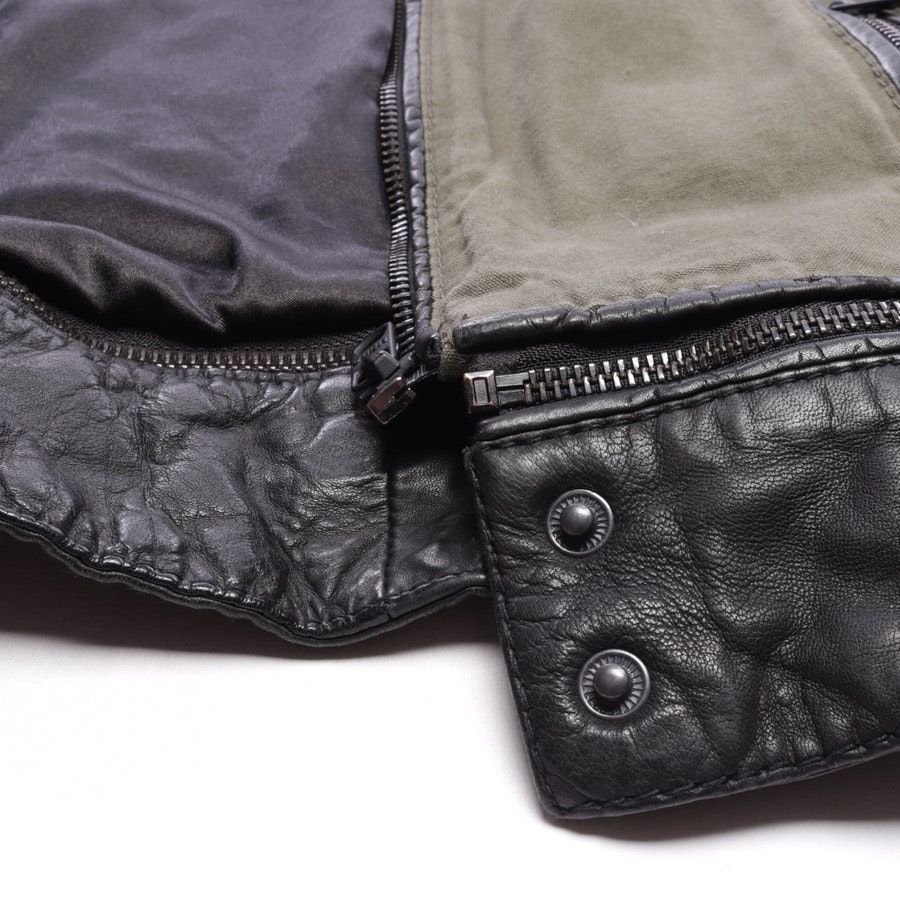 between-seasons jackets from Tigha in olive green and black size M