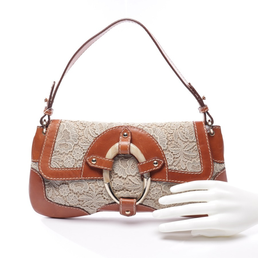 evening bags from Red Valentino in cognac and beige