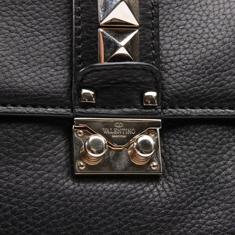 shoulder bag from Valentino in black and gold