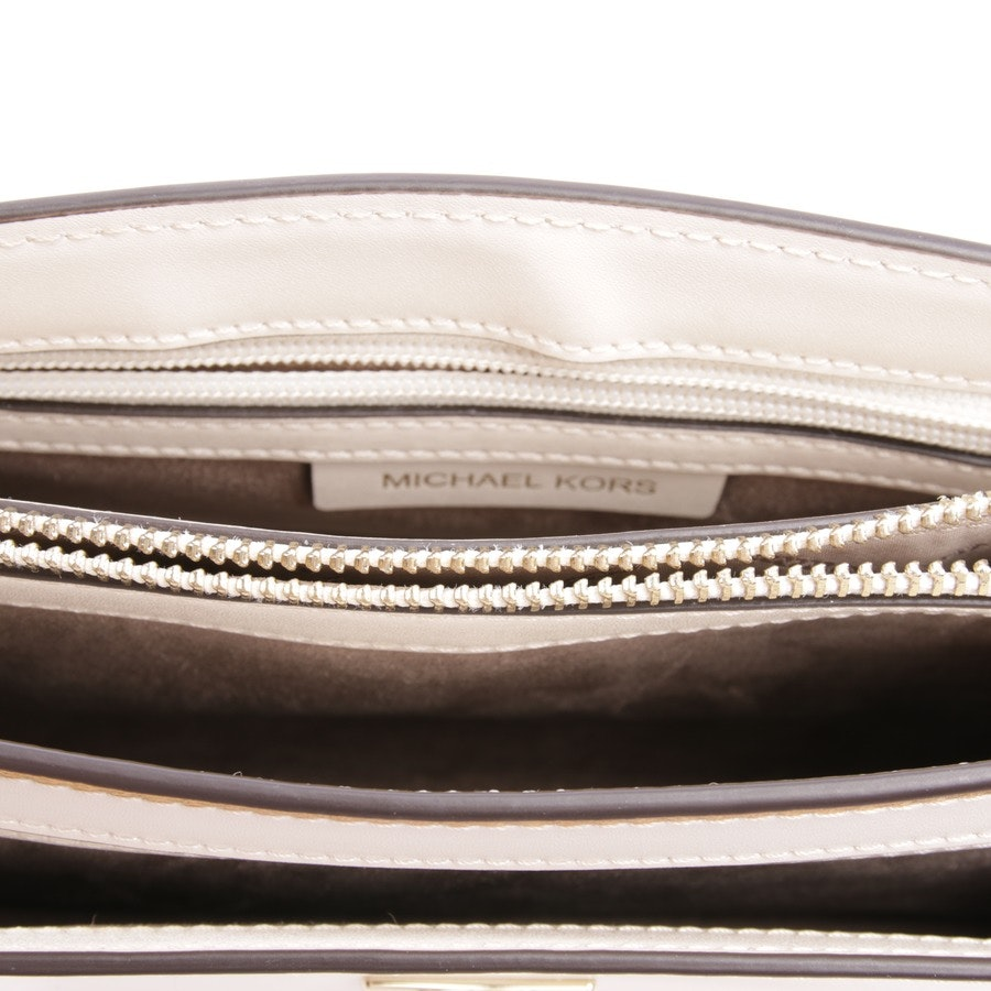 evening bags from Michael Kors in cream
