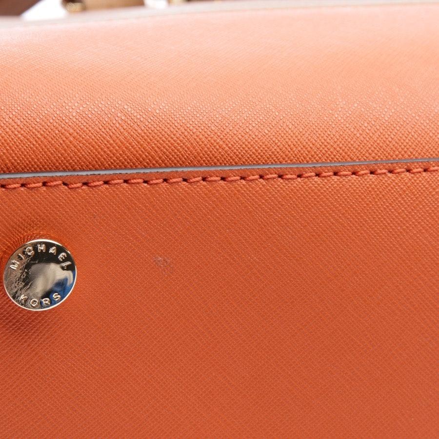 handbag from Michael Kors in brown and orange