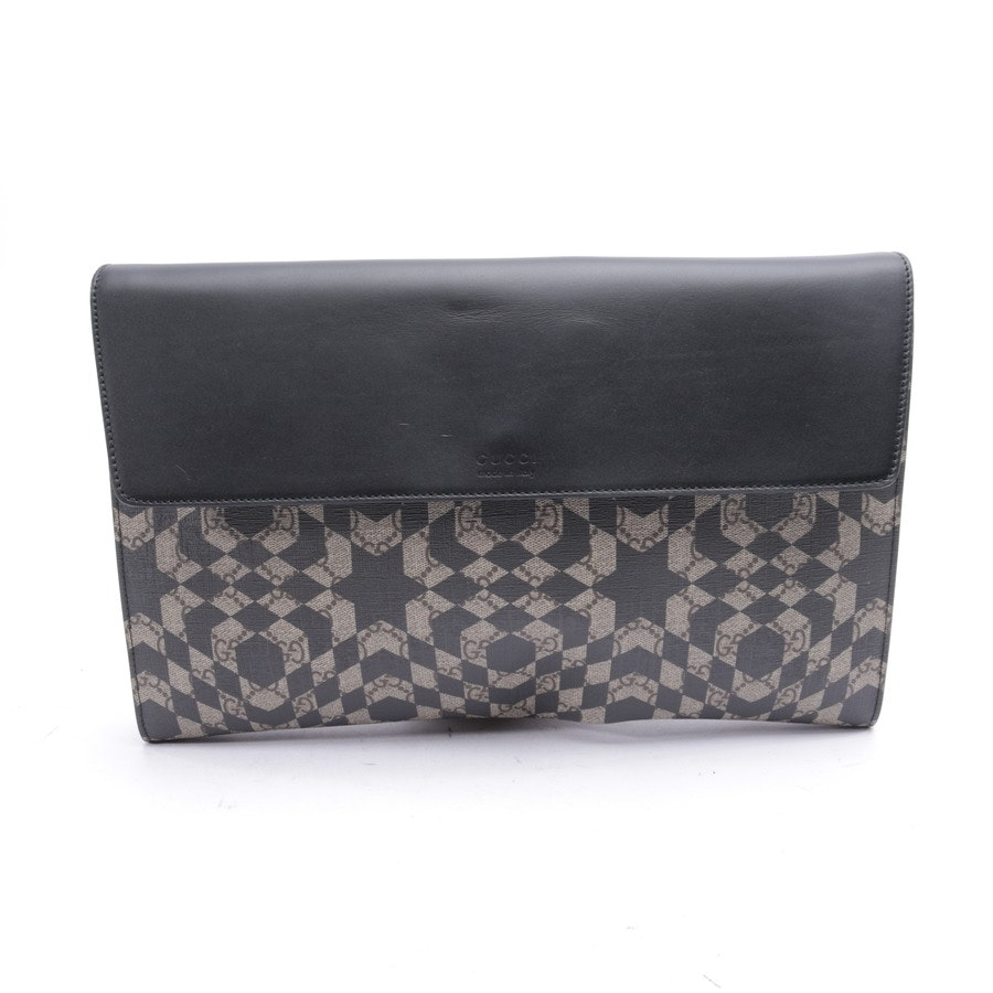 clutches from Gucci in black and beige
