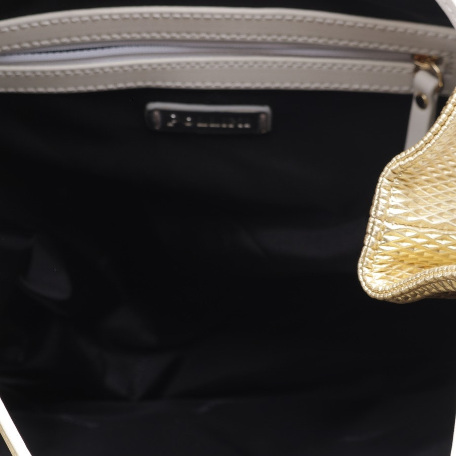 backpack from Pollini in gold and white - new