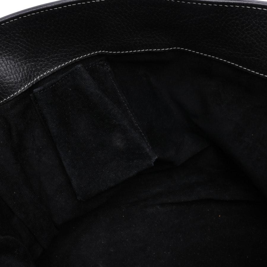 Schultertasche von Unützer in Schwarz