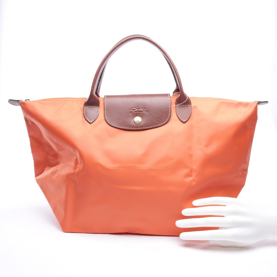 handbag from Longchamp in orange and brown - le pliage m