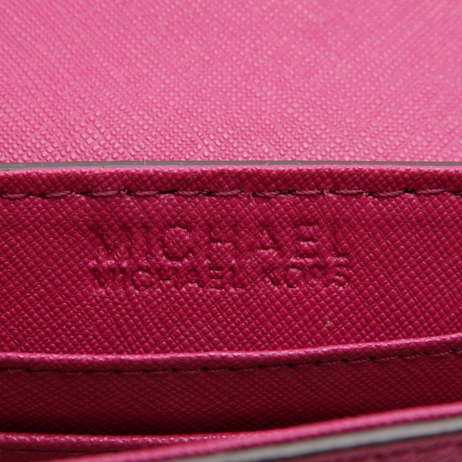 evening bags from Michael Kors in fuchsia