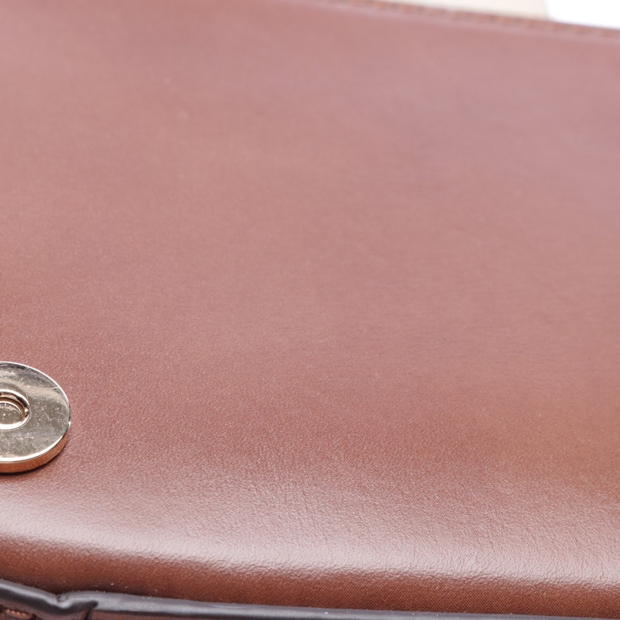 evening bags from Michael Kors in brown