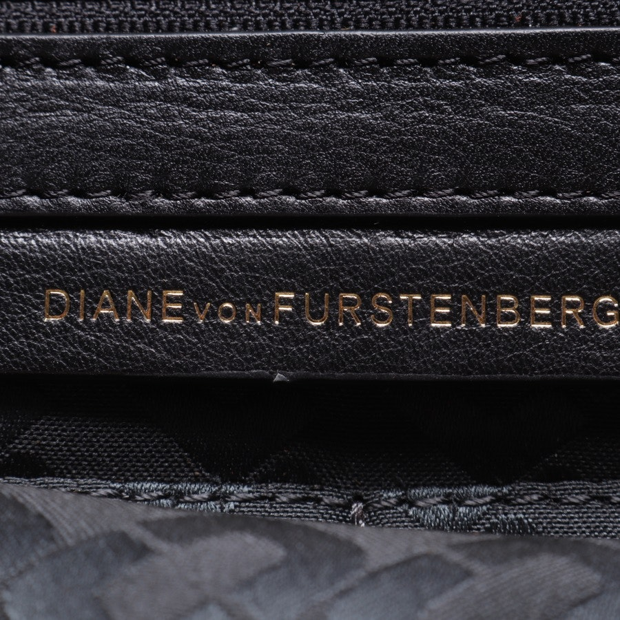 clutches from Diane von Furstenberg in khaki