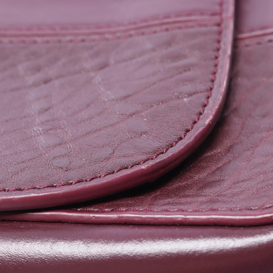shoulder bag from Hugo Boss in aubergine and black