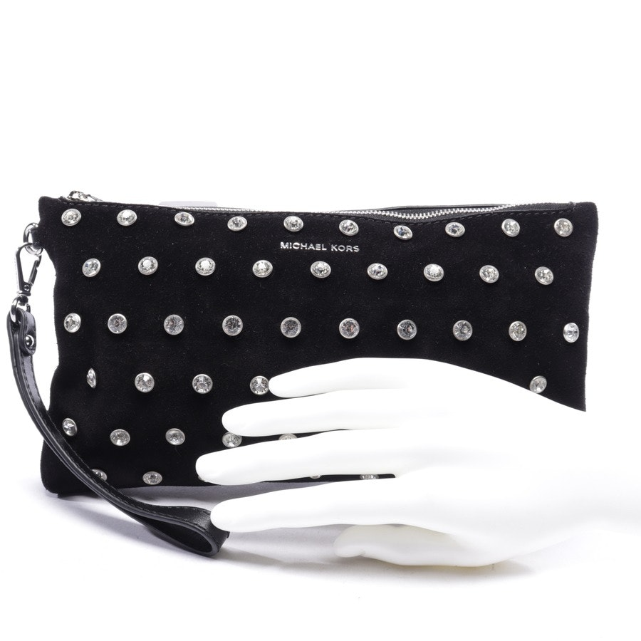 evening bags from Michael Kors in black and white