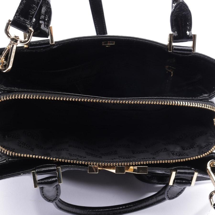 handbag from Michael Kors in black and gold