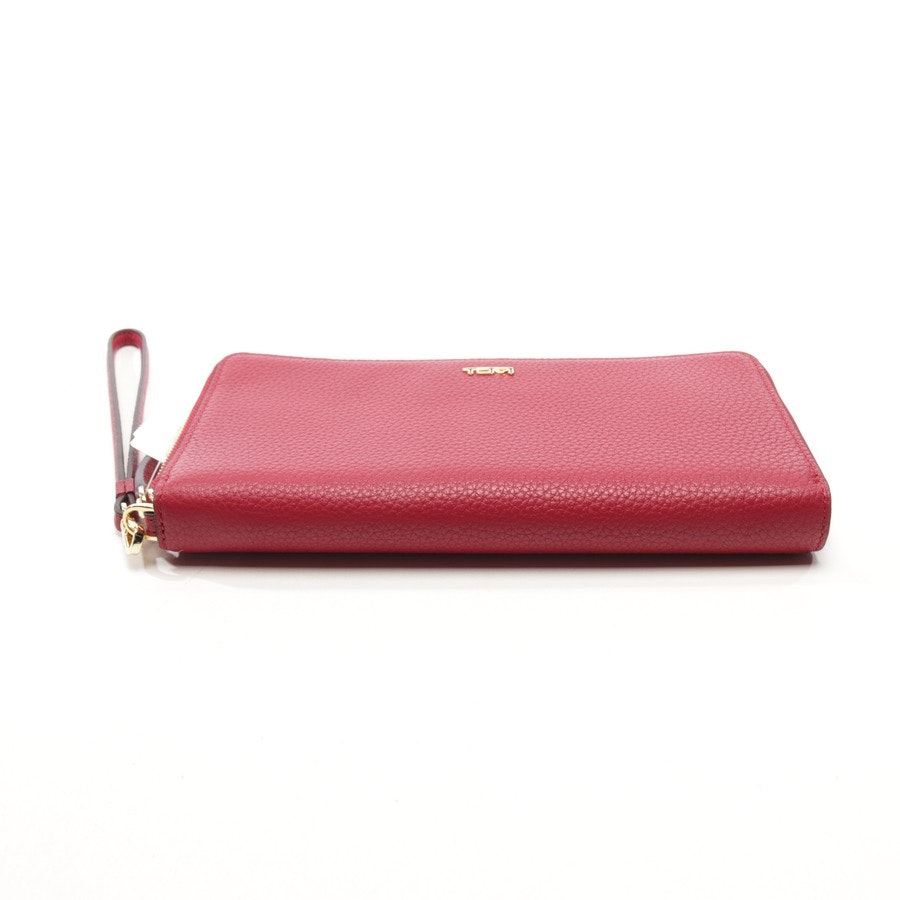 wallets from Tumi in burgundy