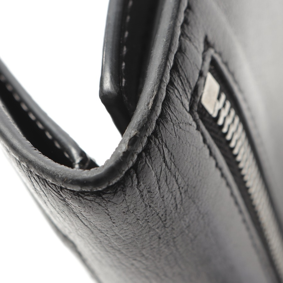 wallets from Givenchy in black and green