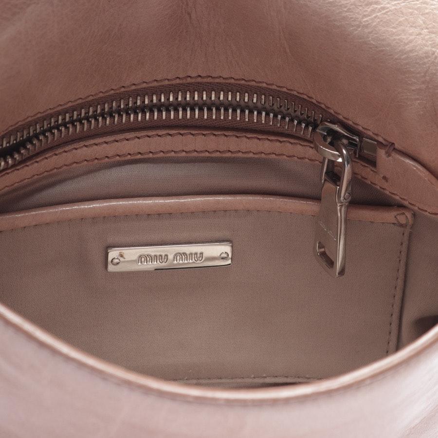 evening bags from Miu Miu in beigepink