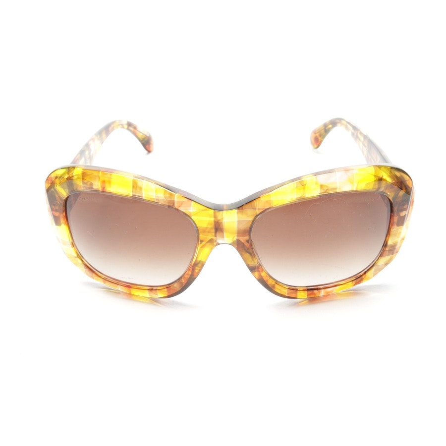 sunglasses from Chanel in brown and yellow