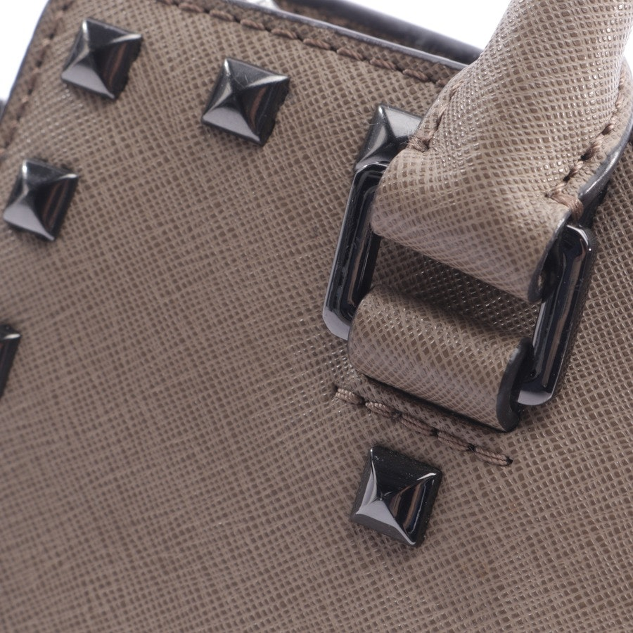 handbag from Michael Kors in taupe