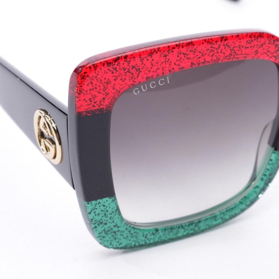 Sonnenbrille von Gucci in Schwarz und Grün - GG0083S - Neu