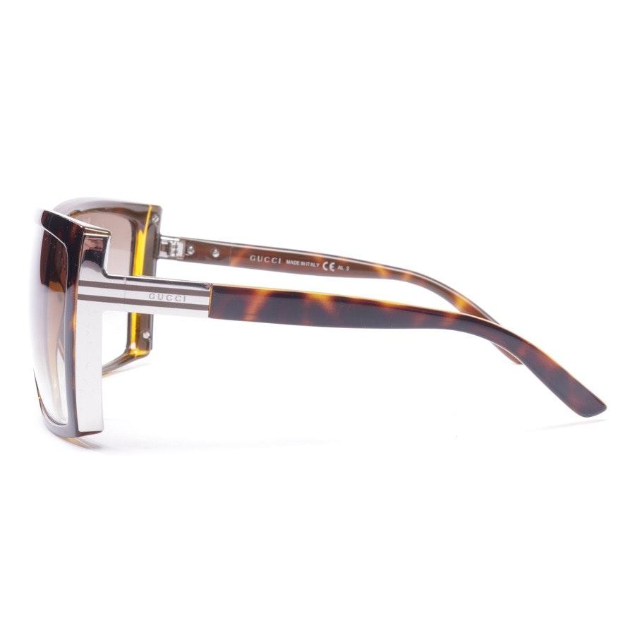 Sonnenbrille von Gucci in Beigebraun und Silber