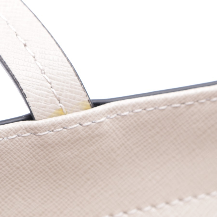 shoulder bag from Coccinelle in cream