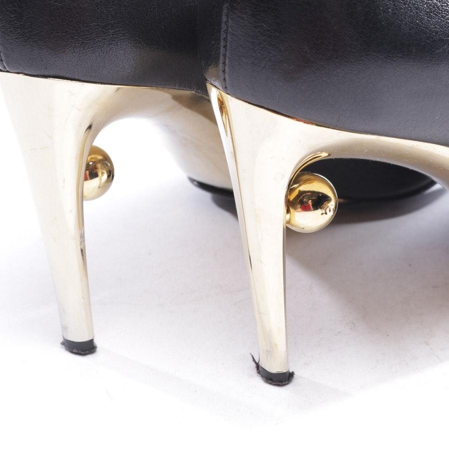 Pumps von Chanel in Schwarz und Gold Gr. D 38