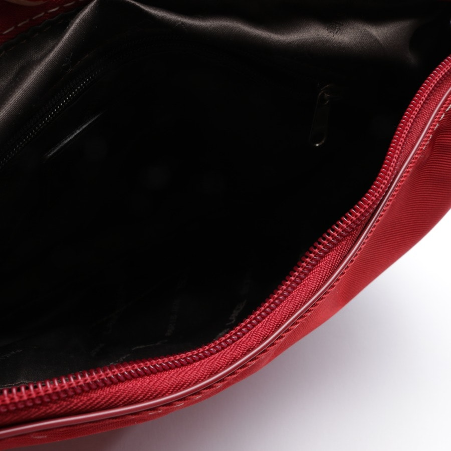 shoulder bag from Lancel in red and brown